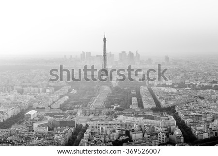 Skyline of Paris, France with Eiffel Tower in Black and White with houses, streets and parks and business district La Defense in the background