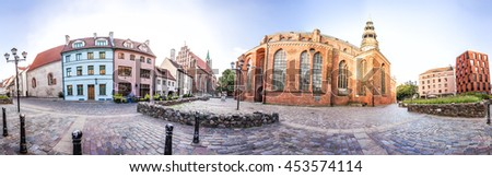 Skyline of Riga old Town. Small Square with Old houses near the St. Peter and St. John's Churches. Panoramic montage of 41 HDR image - stock photo
