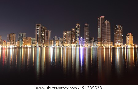 Skyline of Sharjah City at night, United Arab Emirates
