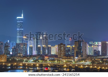 Skyline of Shenzhen City, China at twilight. Viewed from Hong Kong - stock photo