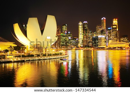 Skyline of Singapore at night. View from Helix bridge - stock photo