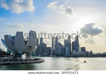 Skyline of Singapore bay with famous Downton Core at sunset.