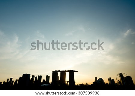 Skyline of SIngapore Silhouetted at sunset.
