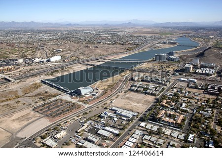 Skyline of Tempe, Arizona including town lake and the Arts Center looking northeast - stock photo