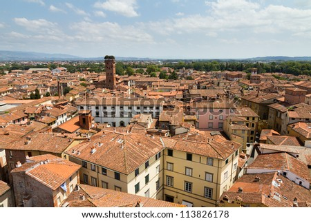 Skyline of the city of Lucca, Italy. Seen from the Torre delle ore towards the Guinigi tower - stock photo