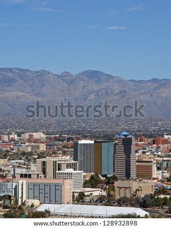 Skyline of the city of Tucson, Arizona showing the Catalina mountains and beautiful blue sky in the background - stock photo