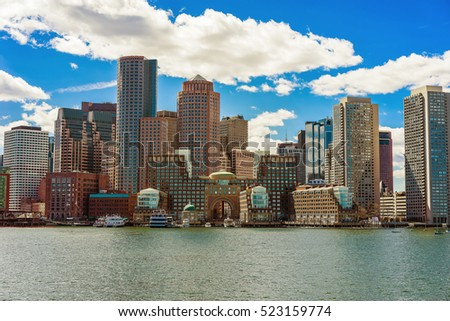 Skyline of the Financial district in Boston, USA. The city is home for the 251 completed skyscrapers. Boston is located near the water and people ofter use ships and boats to reach their destination.