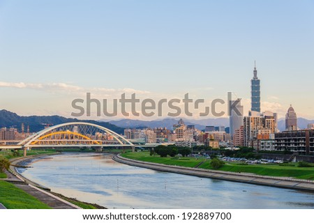 skyline of the taipei city by the river - stock photo