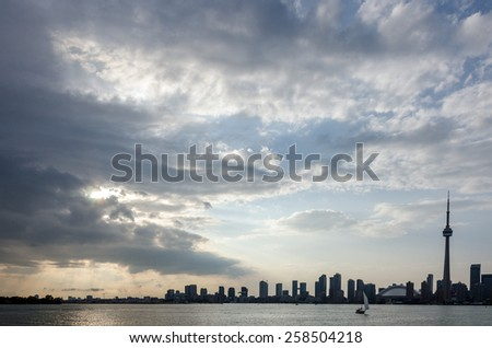 Skyline of Toronto over Ontario Lake at sunset - stock photo