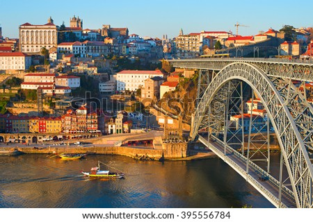 Skyline Porto with famous Dom Luis bridge and traditional rabelo boats on Duoro river. Portugal - stock photo
