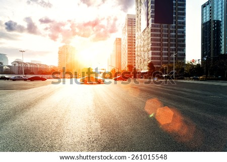 skyline,urban road and office buildings at sunset - stock photo