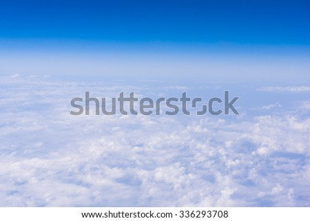 Skyline View above the Clouds from air plane.  Sky background - stock photo