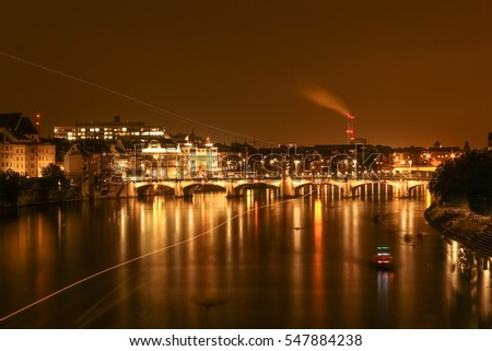 Skyline View of Basel, Switzerland at Night With Lights Illuminating City - Color
