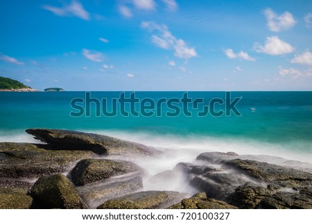Skyline View of Rocks and Waves with Long Exposure against Clear Sky, Seascape Long Exposure, The Water is smooth as silk, Phuket, Thailand.