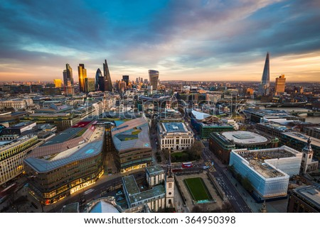 Skyline view of the famous financial bank district of London at magic hour. This view includes famous skyscrapers, office buildings and beautiful sky after sunset - London, UK - stock photo
