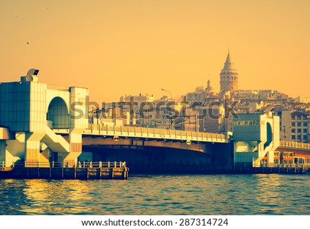 Skyline view on Istanbul - turkish landmarks in a Golden Horn at sunset. Galata Bridge and Glata Tower - romantic travel in Turkey. - stock photo