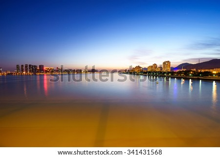 skyline,water and reflection of buildings at dusk