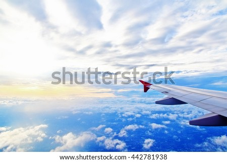 Skyscape with wing of plane