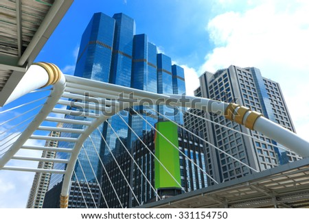 Skyscaper in business district in afternoon - stock photo