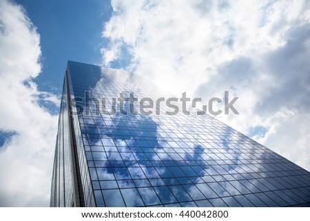 Skyscraper against blue sky - stock photo