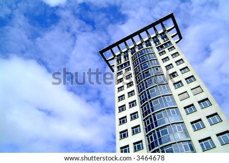 skyscraper against cloudy sky