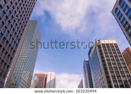 skyscraper against sky and building in city. - stock photo