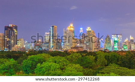 Skyscraper and Cityscape in Bangkok, Thailand; many modern condominiums and business buildings surround Lumpini Park which is one of the famous parks in the city. - stock photo