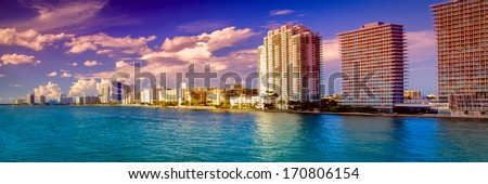 Skyscraper at the waterfront, MacArthur Causeway Bridge, Miami, Florida, USA - stock photo
