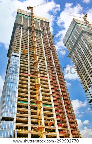 Skyscraper Building under construction in summer day. - stock photo