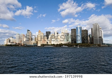 Skyscraper buildings rising above a body of water.