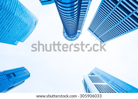 Skyscraper business office building at singapore - Blue tone color processing