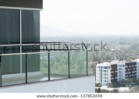 skyscraper, glass and steel made balcony of modern building - stock photo