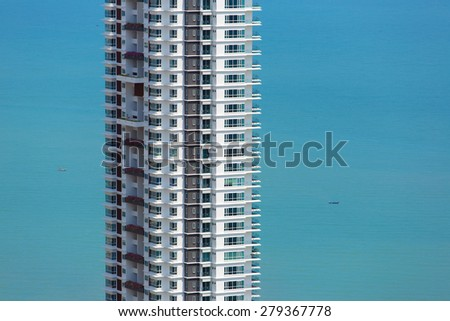 Skyscraper in Penang, Malaysia against blue sea - stock photo
