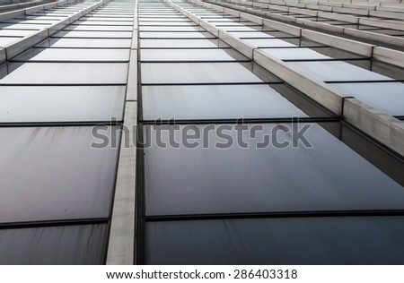 Skyscraper windows close-up with line pattern perspective