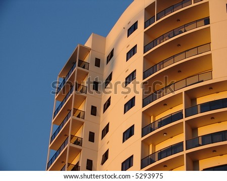 skyscraper with sunset reflection - stock photo