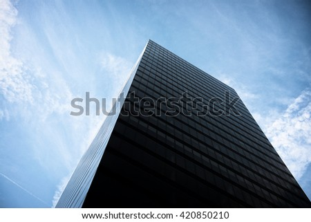 Skyscrapers against blue sky - stock photo