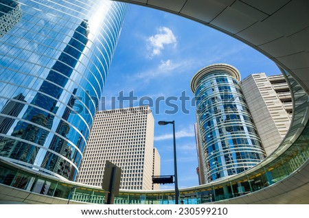 Skyscrapers against blue sky in downtown of Houston, Texas USA - stock photo