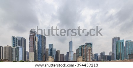 Skyscrapers against the cloudy sky in Chicago, IL, USA. - stock photo