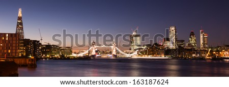 Skyscrapers along the Thames River bank London UK - stock photo