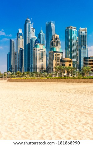 Skyscrapers and jumeirah beach in Dubai Marina. UAE - stock photo