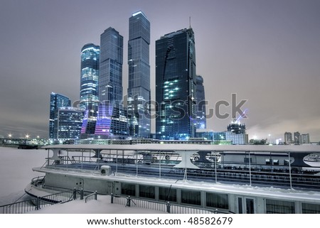 Skyscrapers and steamship in the winter in Moscow - stock photo