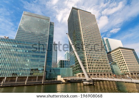 Skyscrapers at Canary Wharf with bridge in the foreground. Docklands, London, England, Europe - stock photo