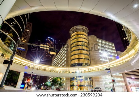 Skyscrapers at night in downtown of Houston, Texas USA - stock photo