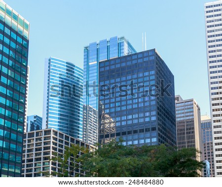 Skyscrapers dominating the cityscape in downtown Chicago, IL, USA. - stock photo