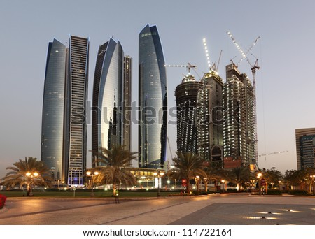 Skyscrapers in Abu Dhabi at dusk, United Arab Emirates - stock photo