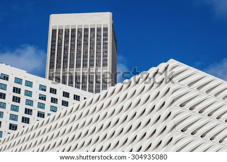 Skyscrapers in downtown LA, Los Angeles. Fragment of a glass skyscraper merged with blue sky - stock photo