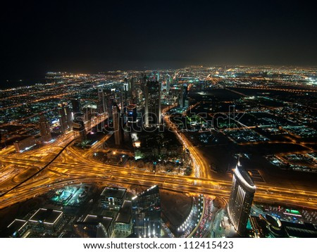 Skyscrapers in Dubai at night. View from the lookout Burj Khalifa. United Arab Emirates