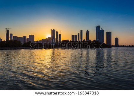 Skyscrapers in Sharjah city. Khalid Lagoon.UAE.