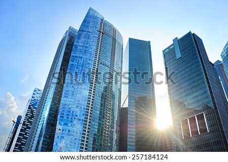 Skyscrapers in Singapore Downtown Core at sunset - stock photo