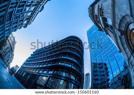 Skyscrapers in the City of London. Blue toned, with fisheye lens. - stock photo